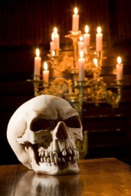 5601603-spooky-skull-lit-by-candles-in-a-chapel